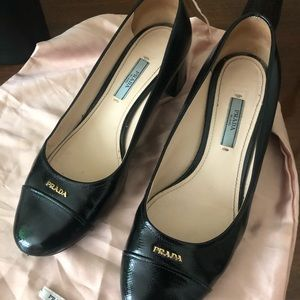Patent Prada block heels in black